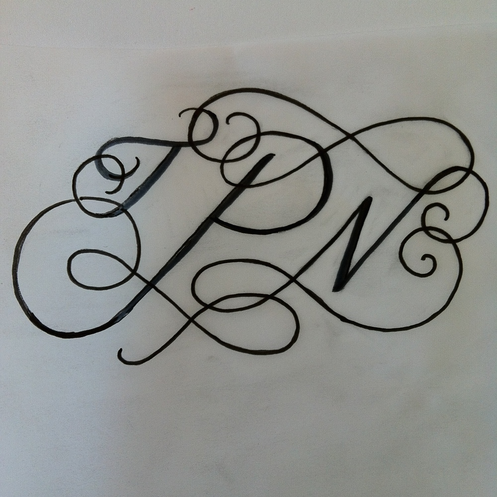 Original rough pen sketch of the monogram.