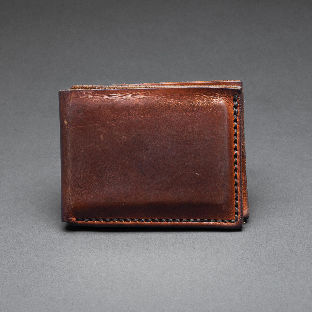 Simon's one year old slimline wallet in antique tan.