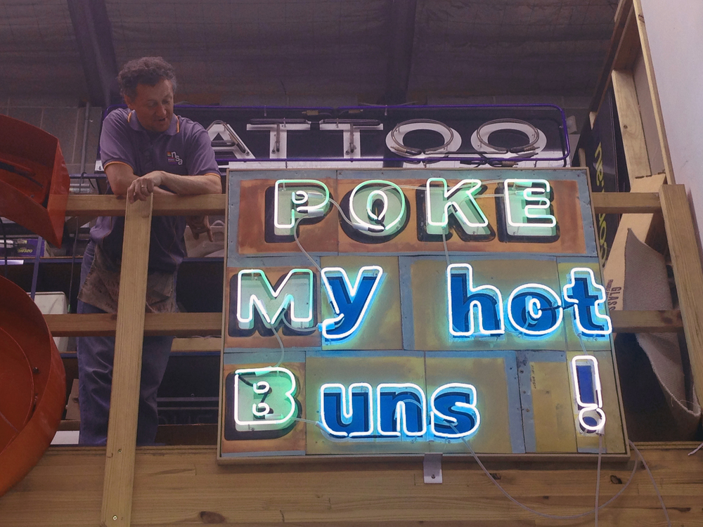 Michael with Hannah Cutts' 'Poke my hot buns' neon artwork