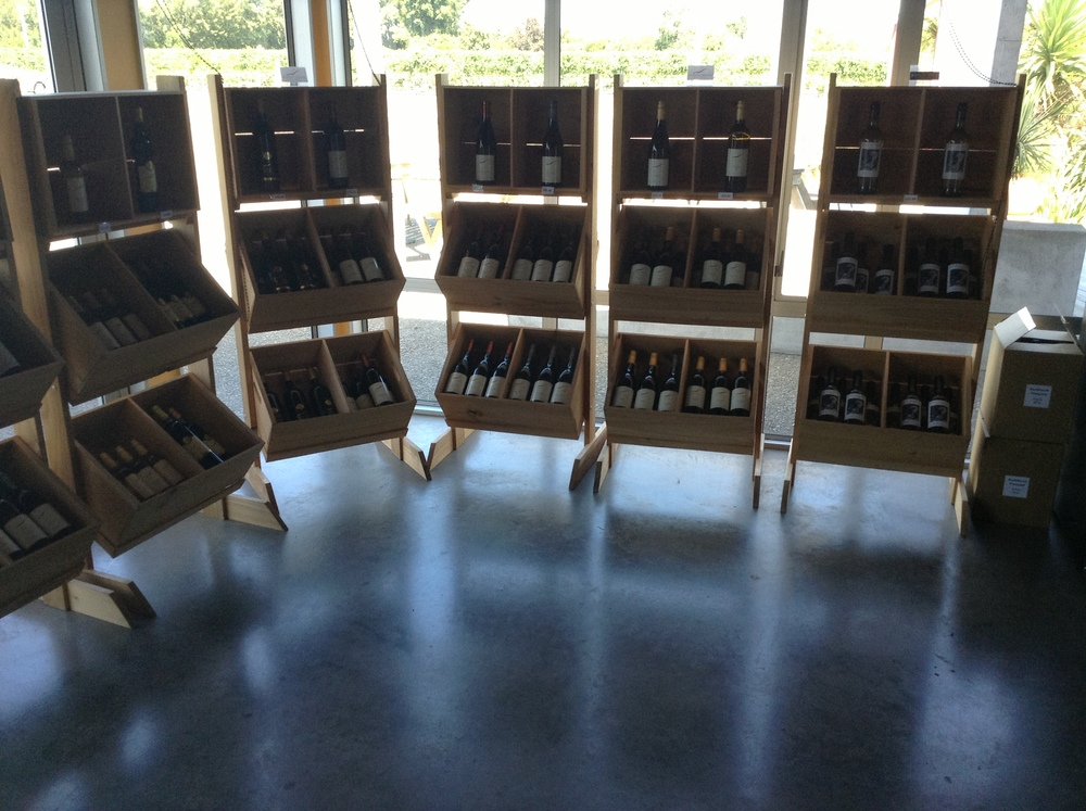 The well-organised selection of wine shelves in the cellar door.