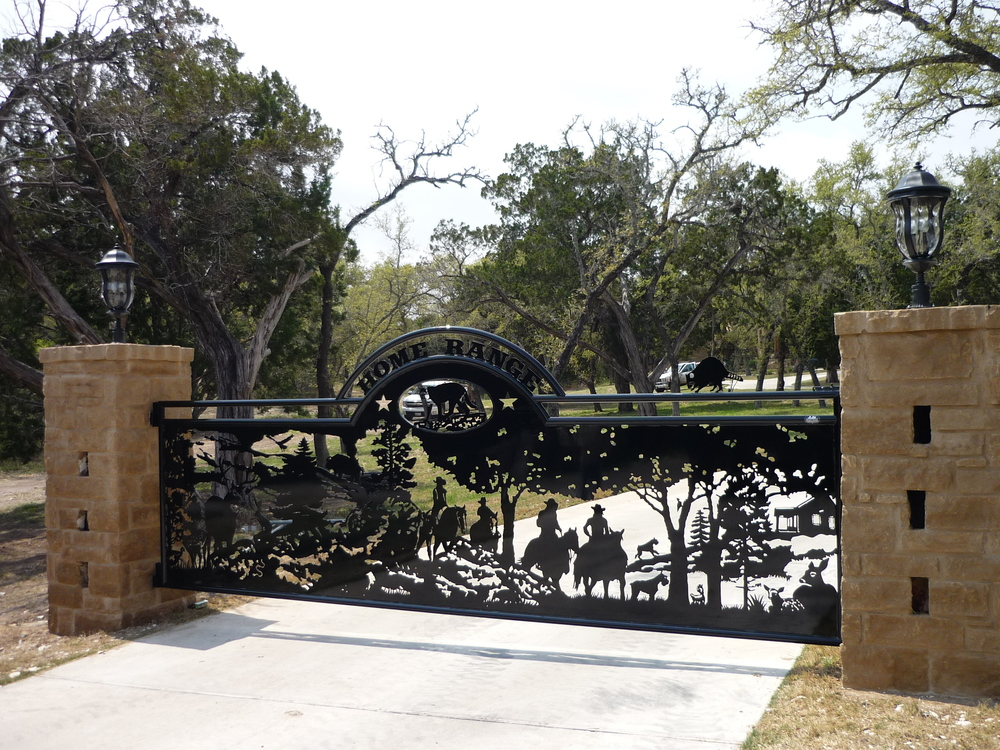 HOME ON THE RANGE  This gate tells the story of a young couple and their two kids in Austin, you will see their two schnauzers if you look close. 16' Single Swing-Custom