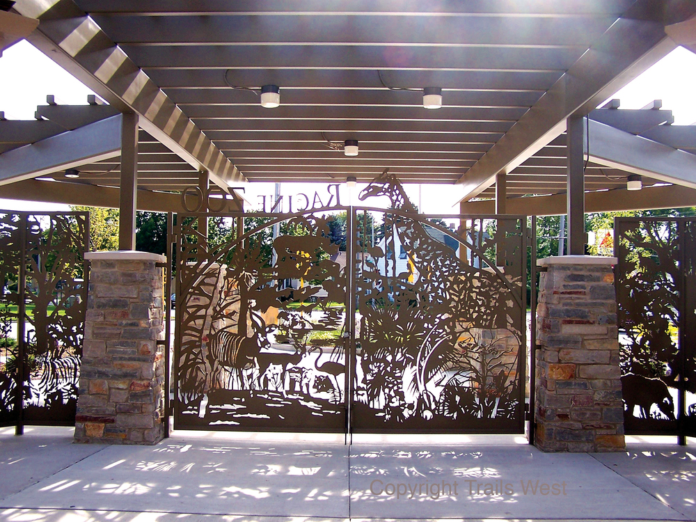 RACINE ZOO WISCONSIN  We worked with a great architect in Wisconsin on this, he sent us blueprints and a list of the zoo's animals. We designed, fabricated and shipped and never met. He gave us free rein and it turned out awesome, love to work that way. He said it fit perfectly. 4 Gates and Side Panels Various Sizes-Custom  dpgrzwrd0049