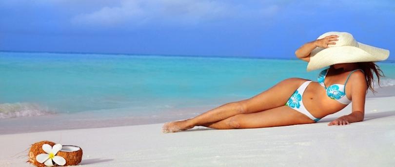 Woman_in_Big_White_Hat_Beach.jpg