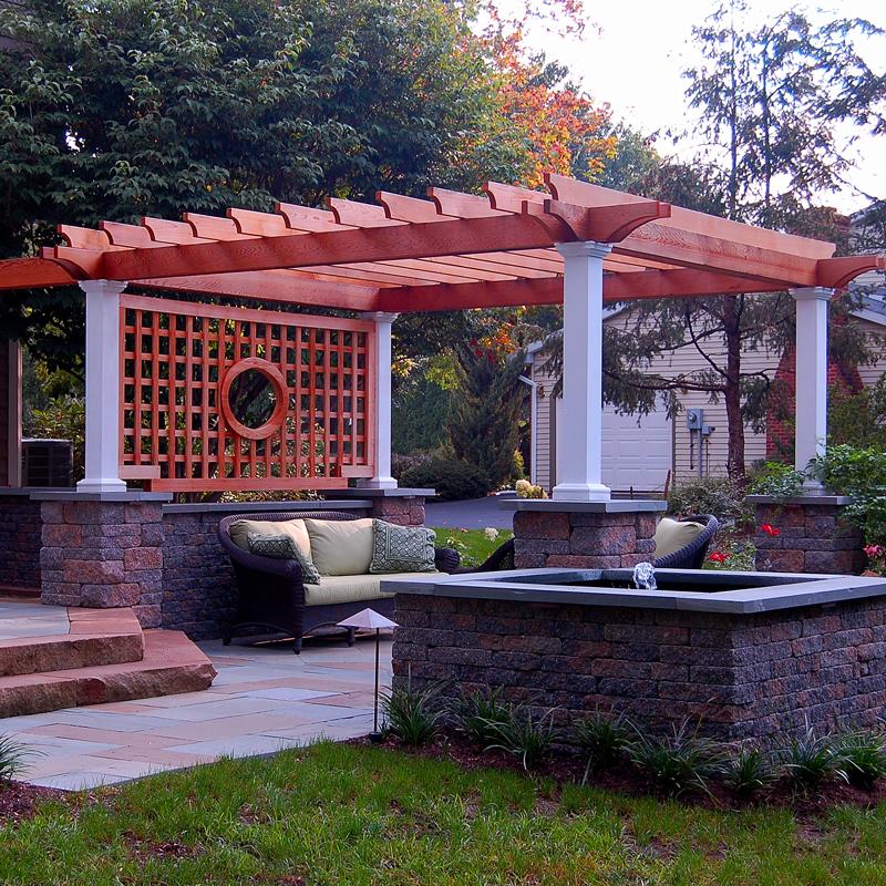 E.P. Henry Coventry walls, Fountain, flagstone patios, cedar pergola and arbor, outdoor lighting. Lititz Pa.