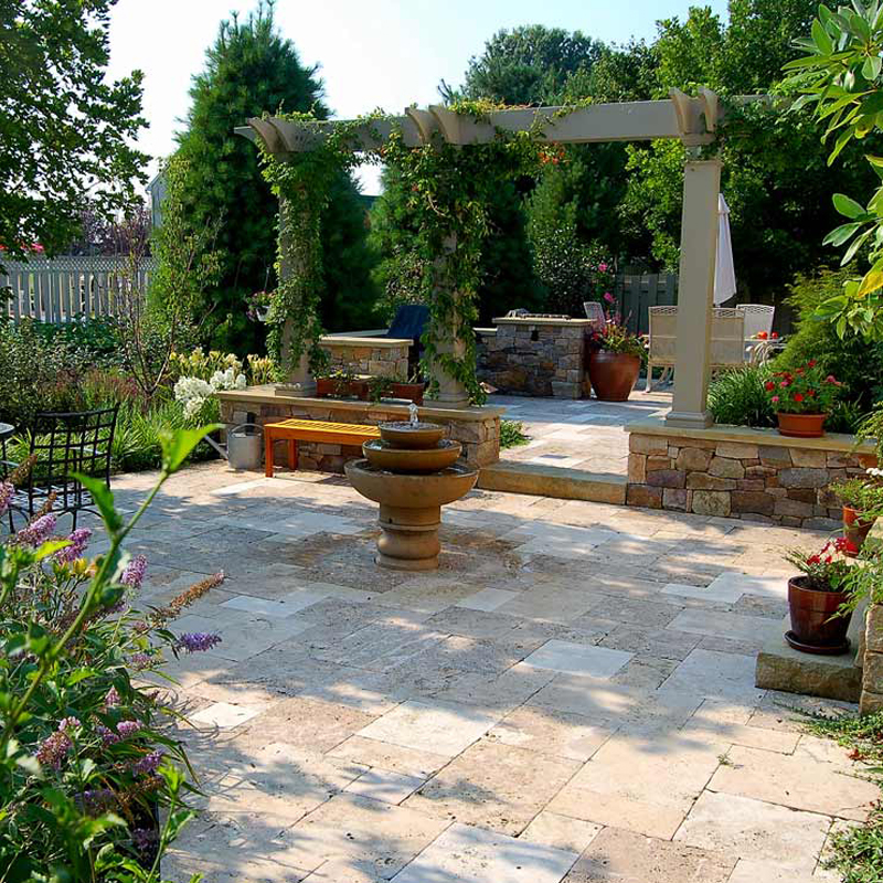 Landscaping Lancaster Pa. Travertine patio, fountain, arbor, outdoor kitchen.