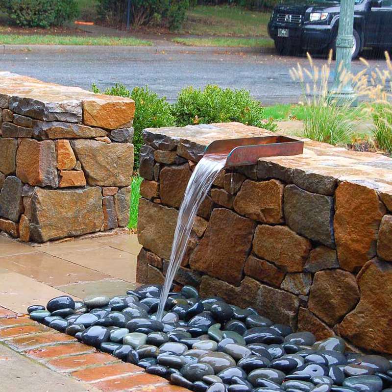 Hershey Pa., natural stone walls, contemporary water feature, modern planting.