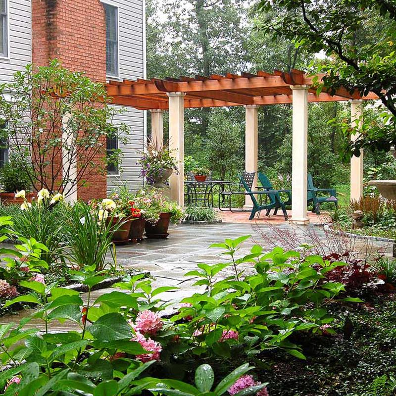 Hershey naturalistic garden, fountain, pergola, flagstone and cobblestone. Outdoor lighting.