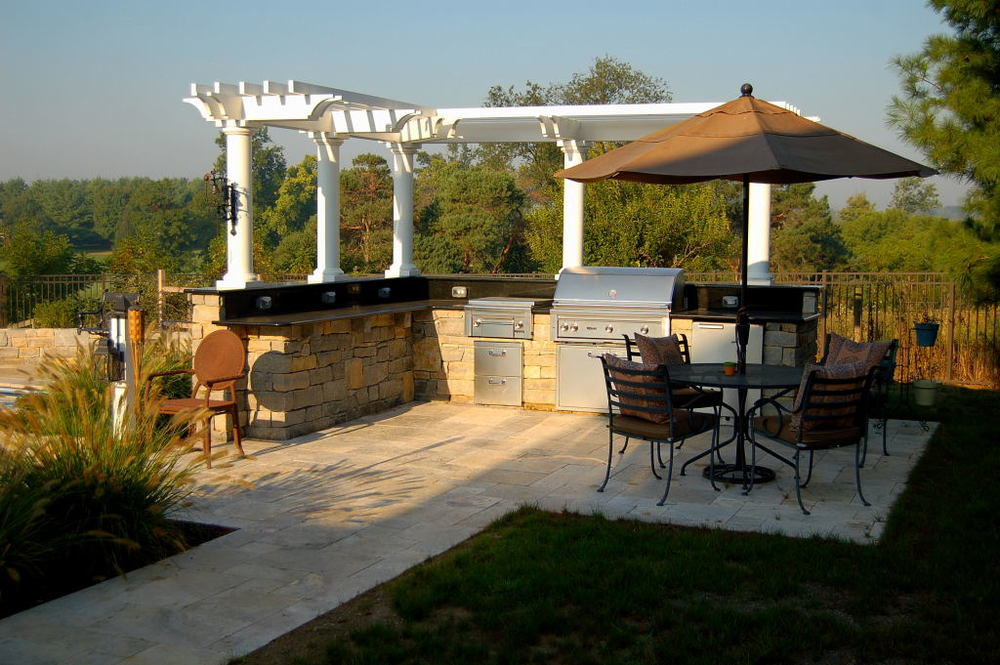 Outdoor Kitchen with White Wooden Arbor