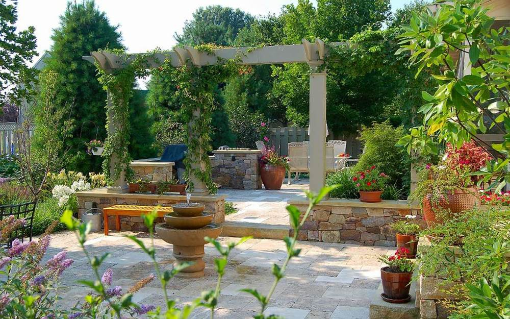 Painted wood pergola and travertine patio in Landisville, Pa