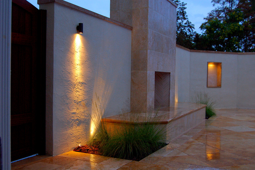Mediterranean style travertine outdoor fireplace