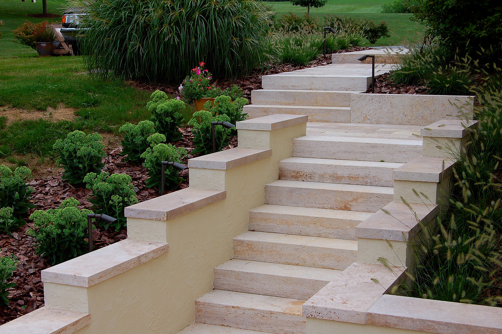 Exterior stairs built with monolithic slab travertine