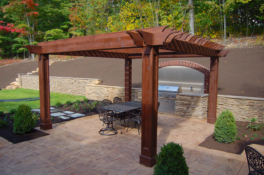 Natural wood pergola and cleft stone patio