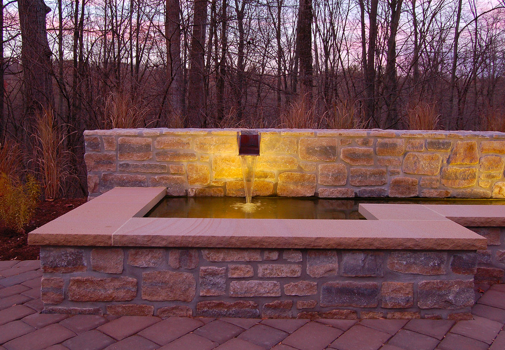 Granite water feature with copper scupper and rill