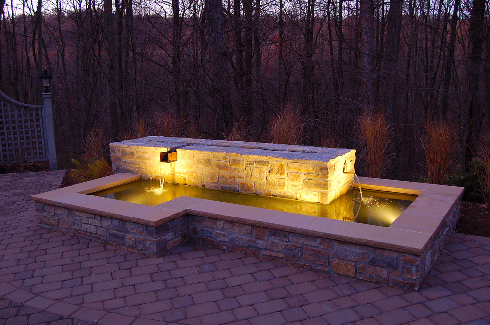 Stone water feature with granite caps and copper