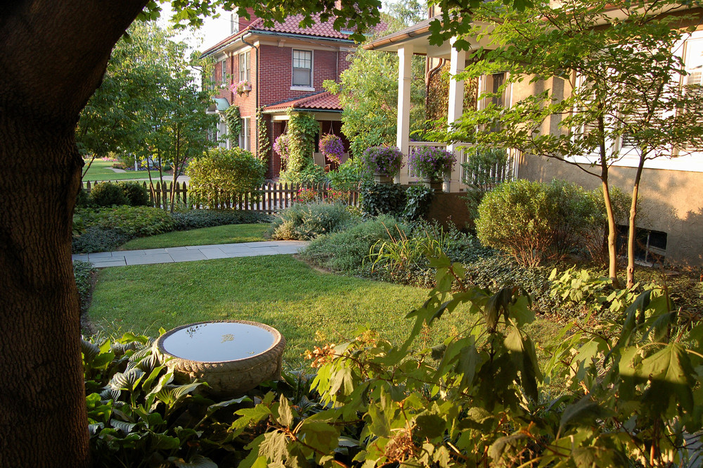 The front yard landscape design has perrennial gardens