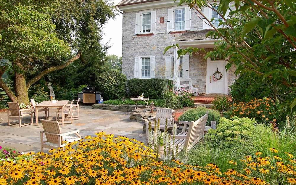 Historic limestone farmhouse landscape