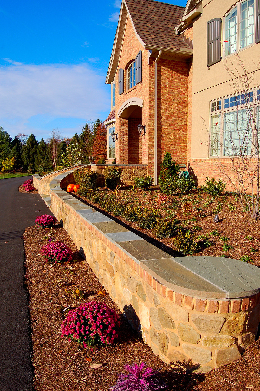 Landscape architecture with front entrance retaining walls