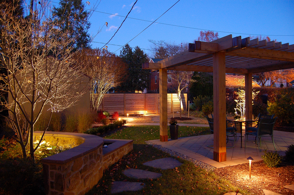 A pergola with copper ends and a contemporary water feature and fence embrace this Lancaster Pa. garden.