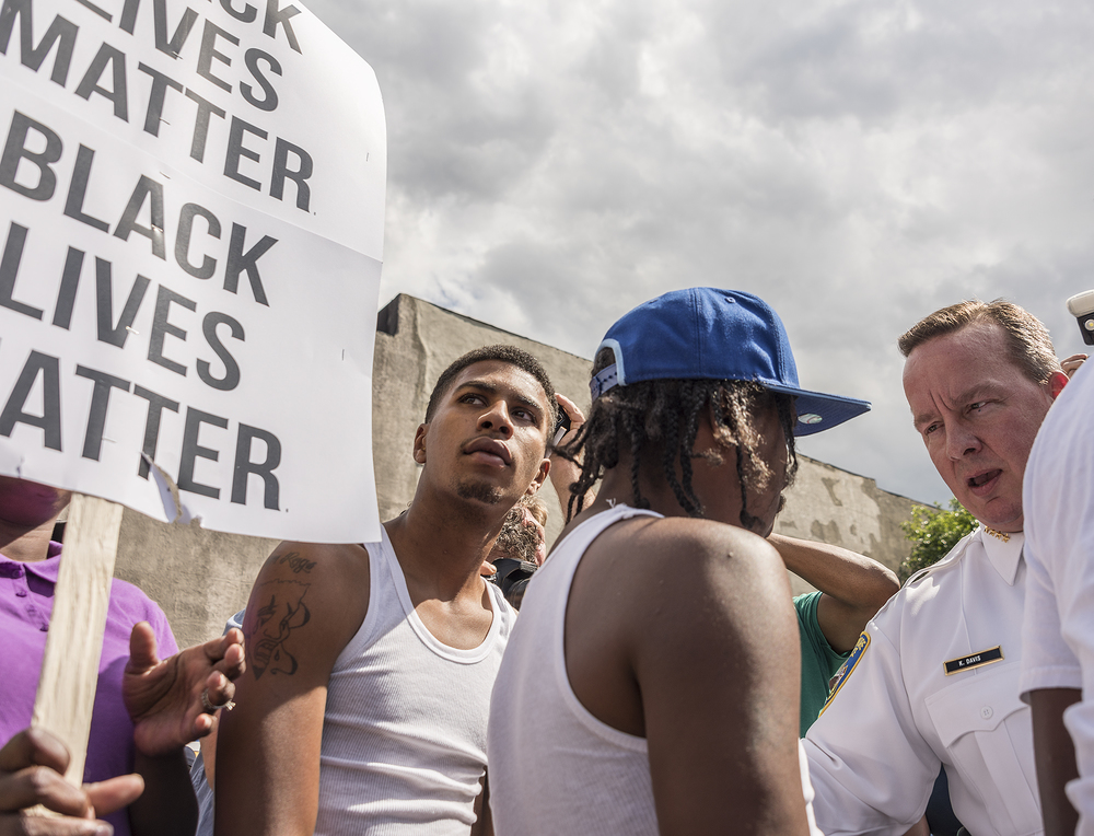 Interim Baltimore Police Commissioner Kevin Davis talks with protestors before the march.