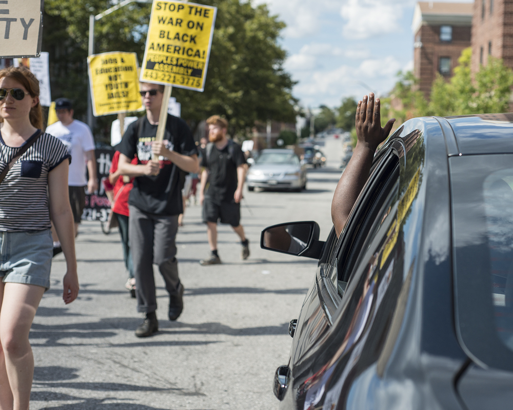 A driver waves to show support for the protestors.