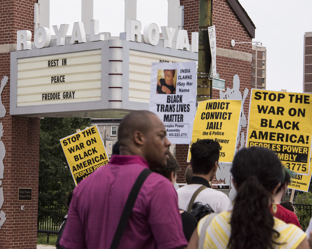 A sign at the Royal Theater Marquee Plaza commemorating Freddie Gray greets the protestors.