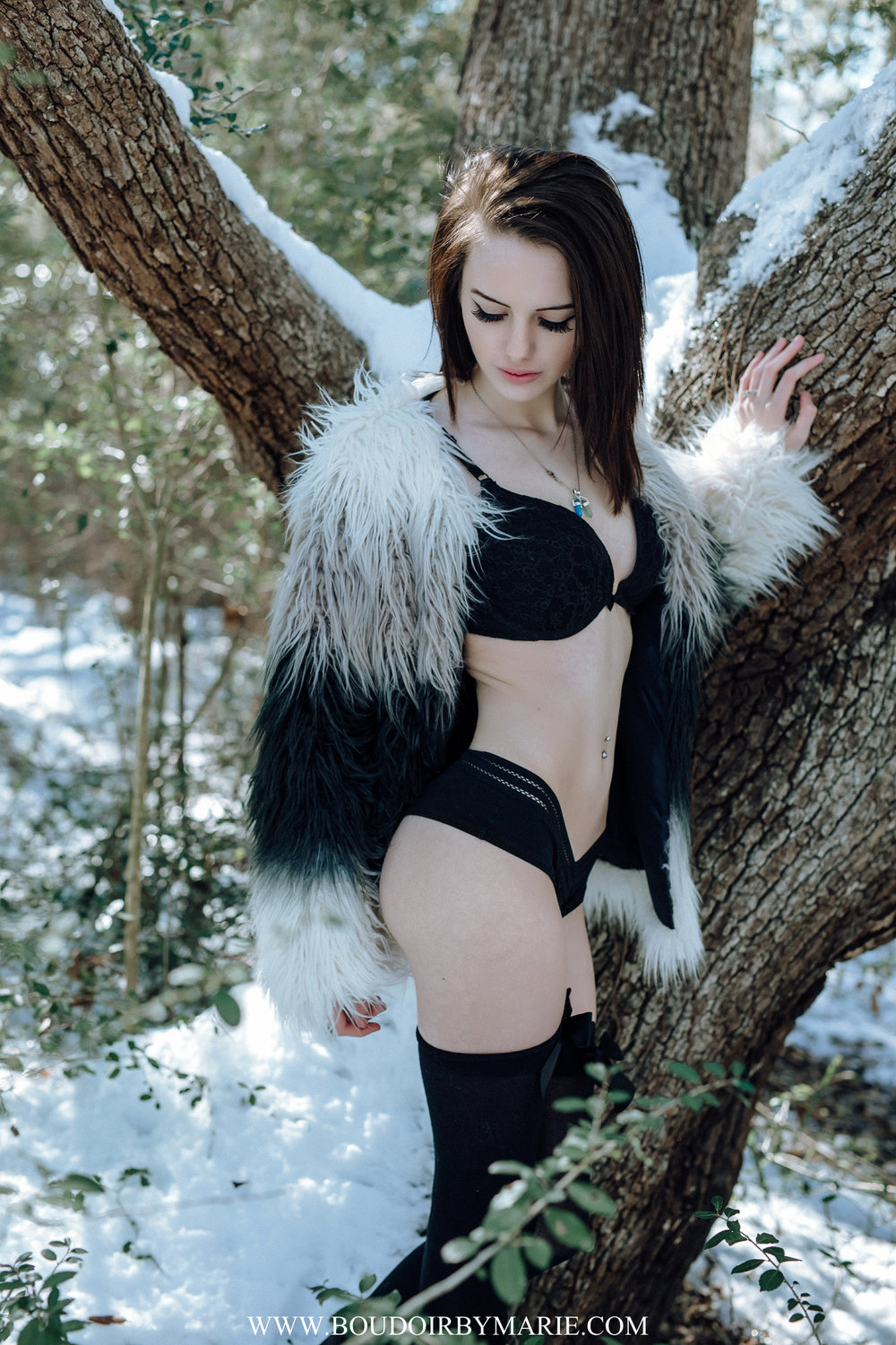 Beautiful brunette girl outside in snow boudoir photograph