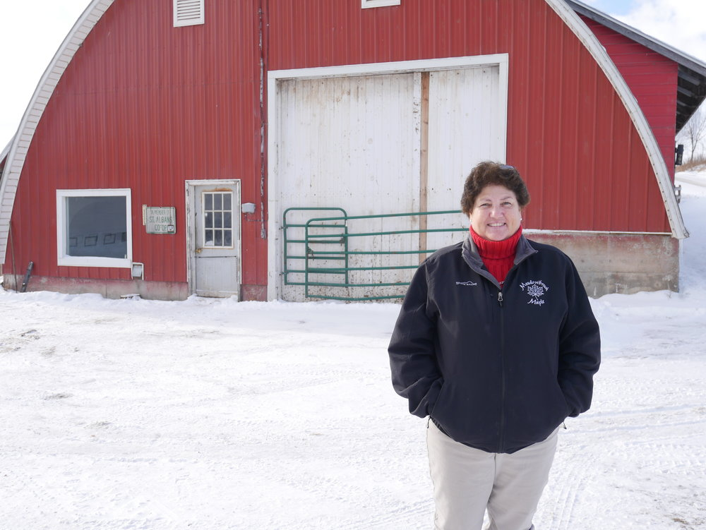 Teresa Richards stands outside the cow barn.