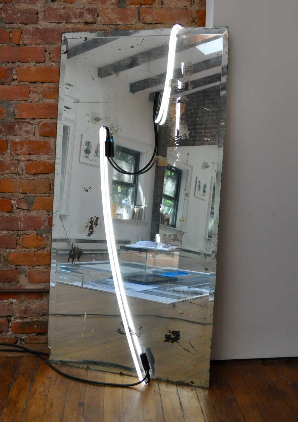 Mirror Piece , 2016  vintage mirror, neons, electrical cables, suction cup 122 x 61 cm