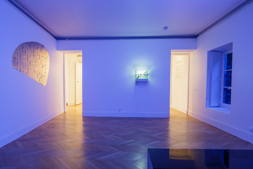 Aurore , 2017 gold leaf on wall, site specific installation dimensions variable, approx : 110 x 175 cm   re - , 2015-16 neon, water, glass, wood 34 x 27 x 20 cm  installation view,  Nuits Américaines , Maison de Chateaubriand, Châtenay-Malabry, 2017-2018   photo : Alexandre Lebrun