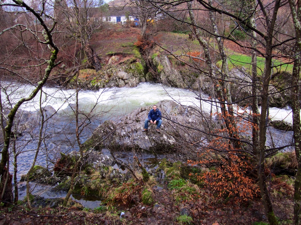 Billy climbs down the slick, muddy bank for a perch on some rocks, leaving Samantha on higher ground planning how she'll rescue him when he's surely swept downriver and knocked unconscious.
