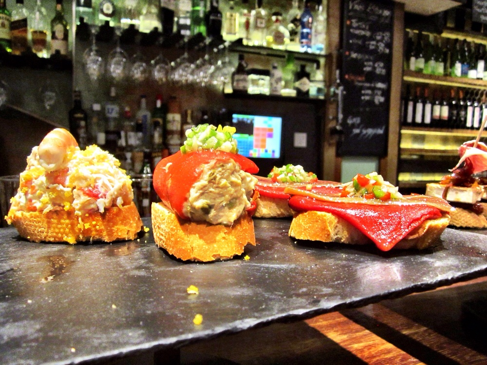 Assorted pintxos on the bar at Atari Gastroteka