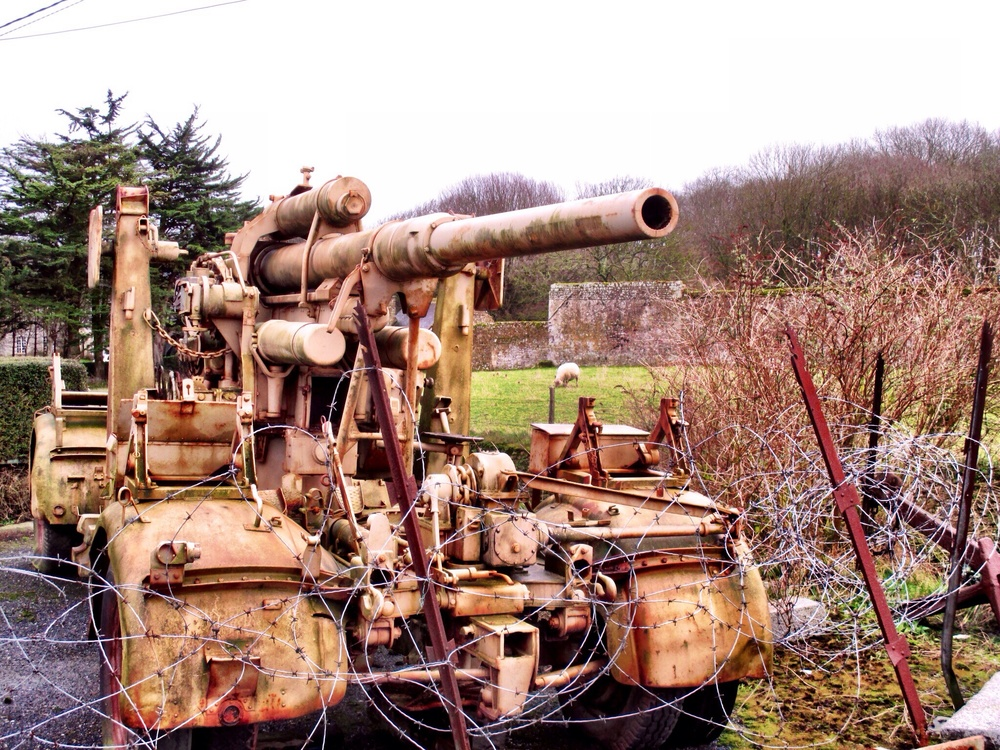 German artillery piece in a Normandy field
