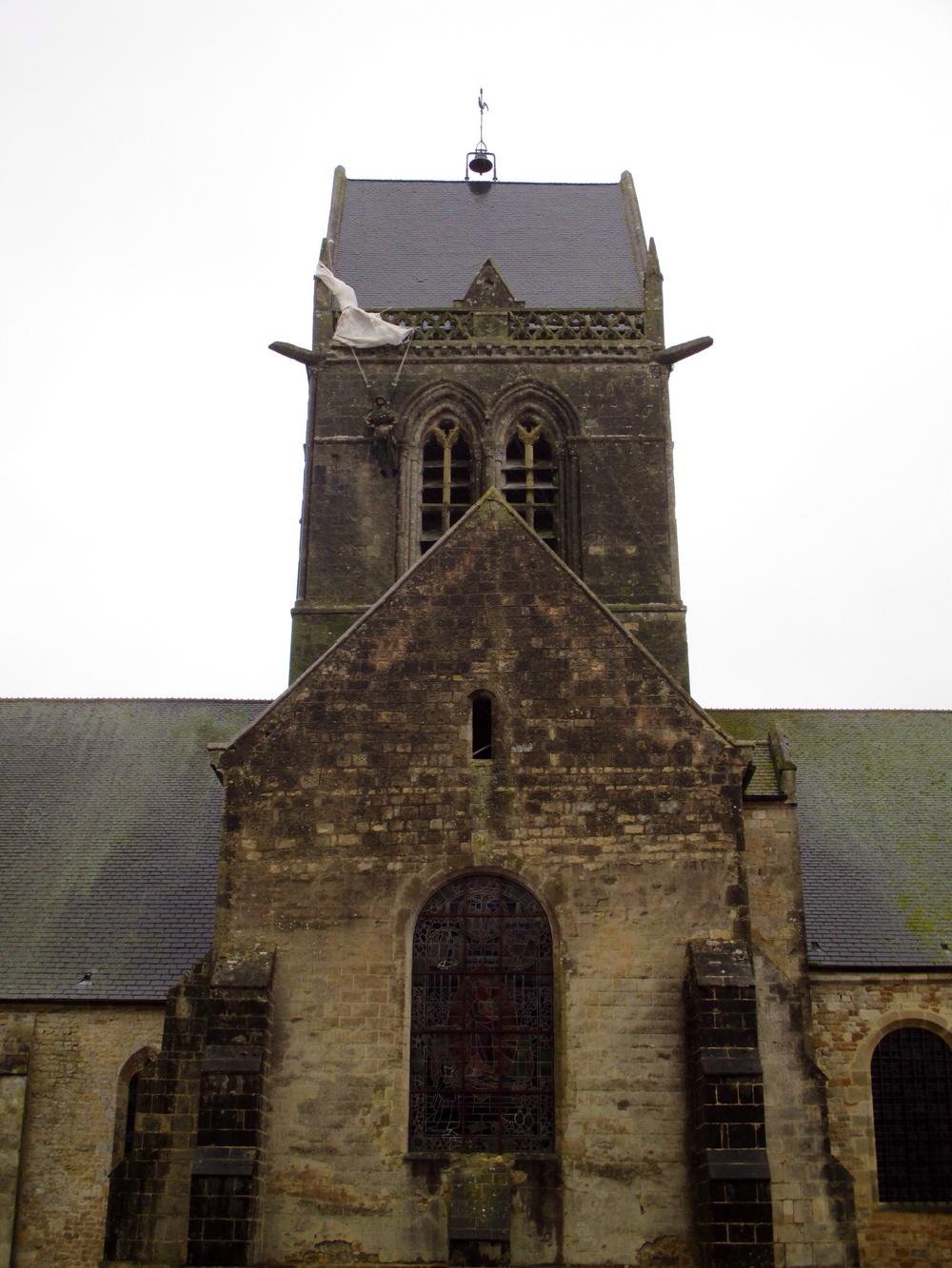 John Steele mannequin on the church at Sainte-Mère-Église