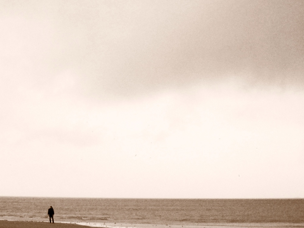 Taking a moment to reflect at Omaha Beach
