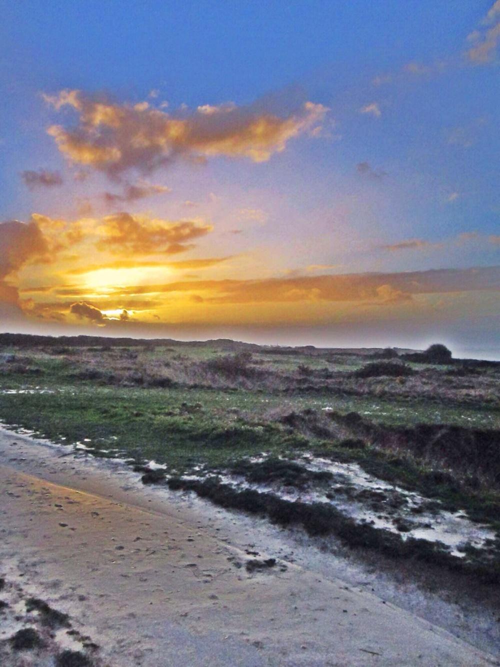 The sun sets on our Normandy tour at Pointe-du-Hoc