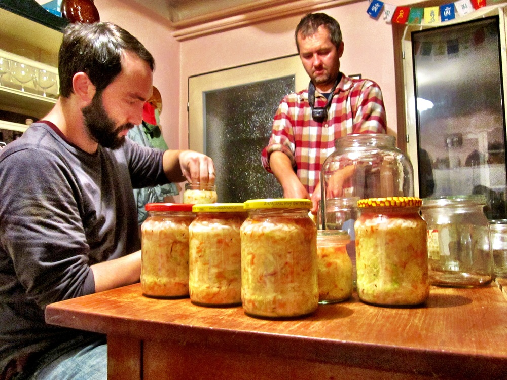 Richard & Bill jarring the pickled cabbage that will see the family through the winter without fresh vegetables.