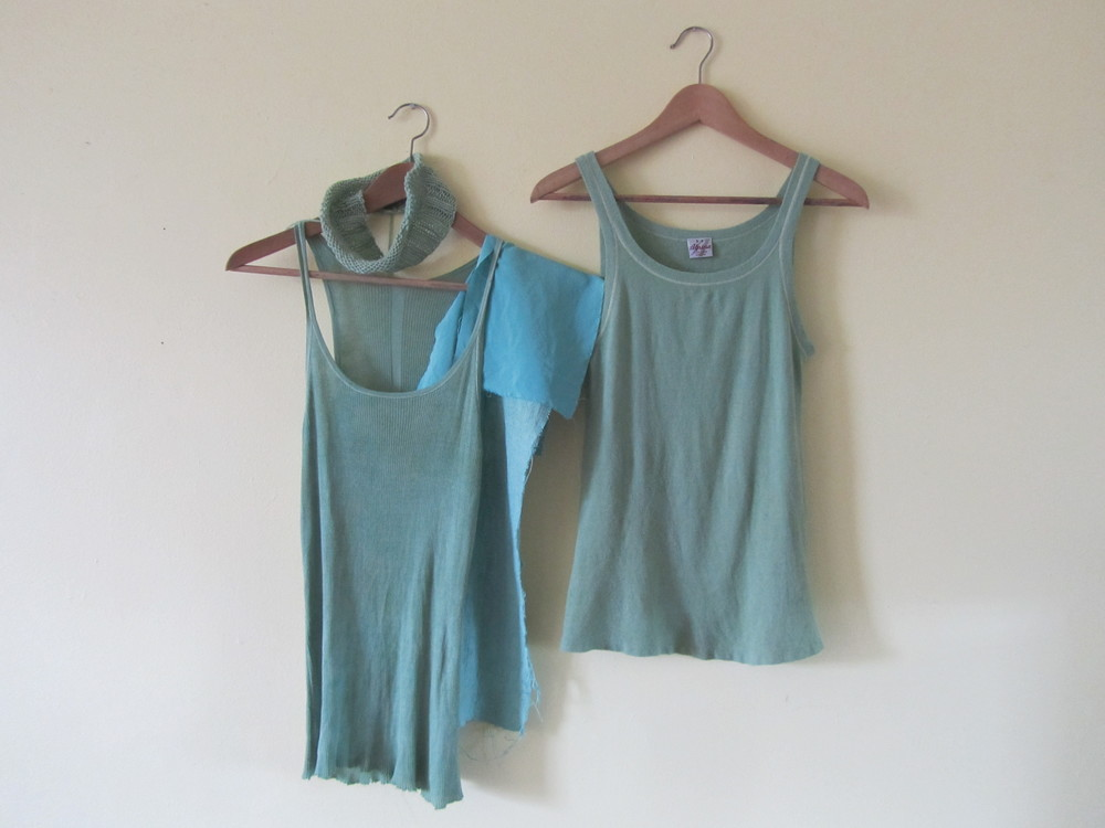 The finished result of the vintage wool top (right) and some other pieces I dyed with the fresh indigo leaves. The aqua blue pieces of fabric in the middle are silk.
