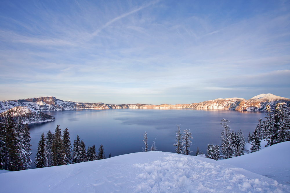 Crater Lake National Park seen on a sunny winter day with lots of snow.