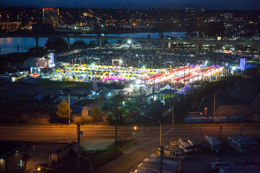 A nighttime aerial view of illuminated tents at the Richmond Night Market near Vancouver, British Columbia.