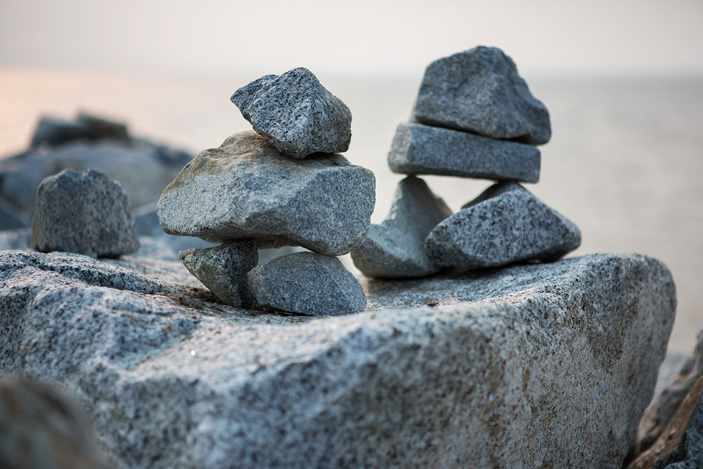 The zen art of stone stacking seen on the jetty at Iona Beach Regional Park.