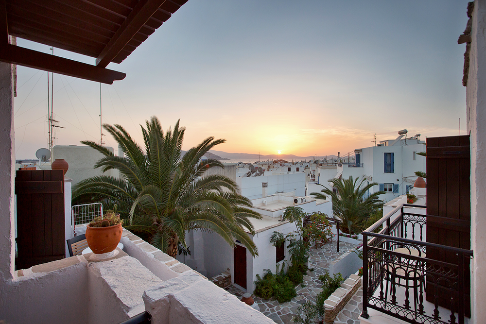 A whitewashed courtyard during sunset on the island of Naxos.