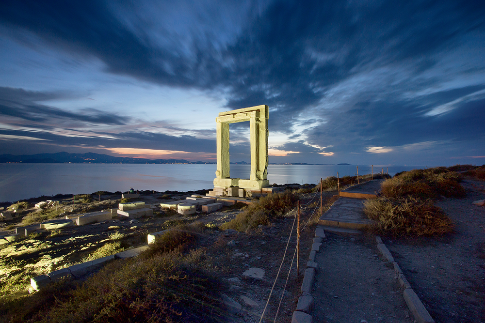 The Portara seen during sunset and under a dramatic sky on the island of Naxos.