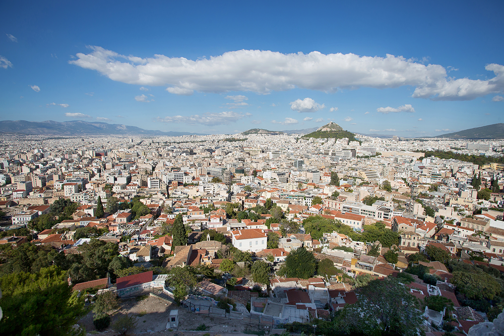 The city of Athens seen from on top of the Acropolis on a sunny day in Greece.