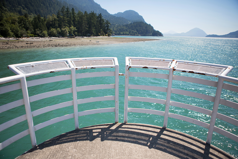 An observation deck overlooking clean, blue water and mountains at Porteau Cove Provincial Park.