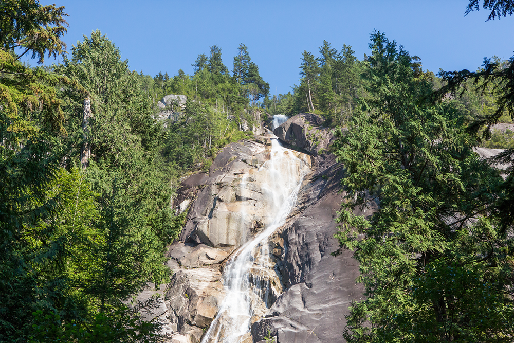 A close up of the multi-story tall waterfall at Shannon Falls Provincial Park.