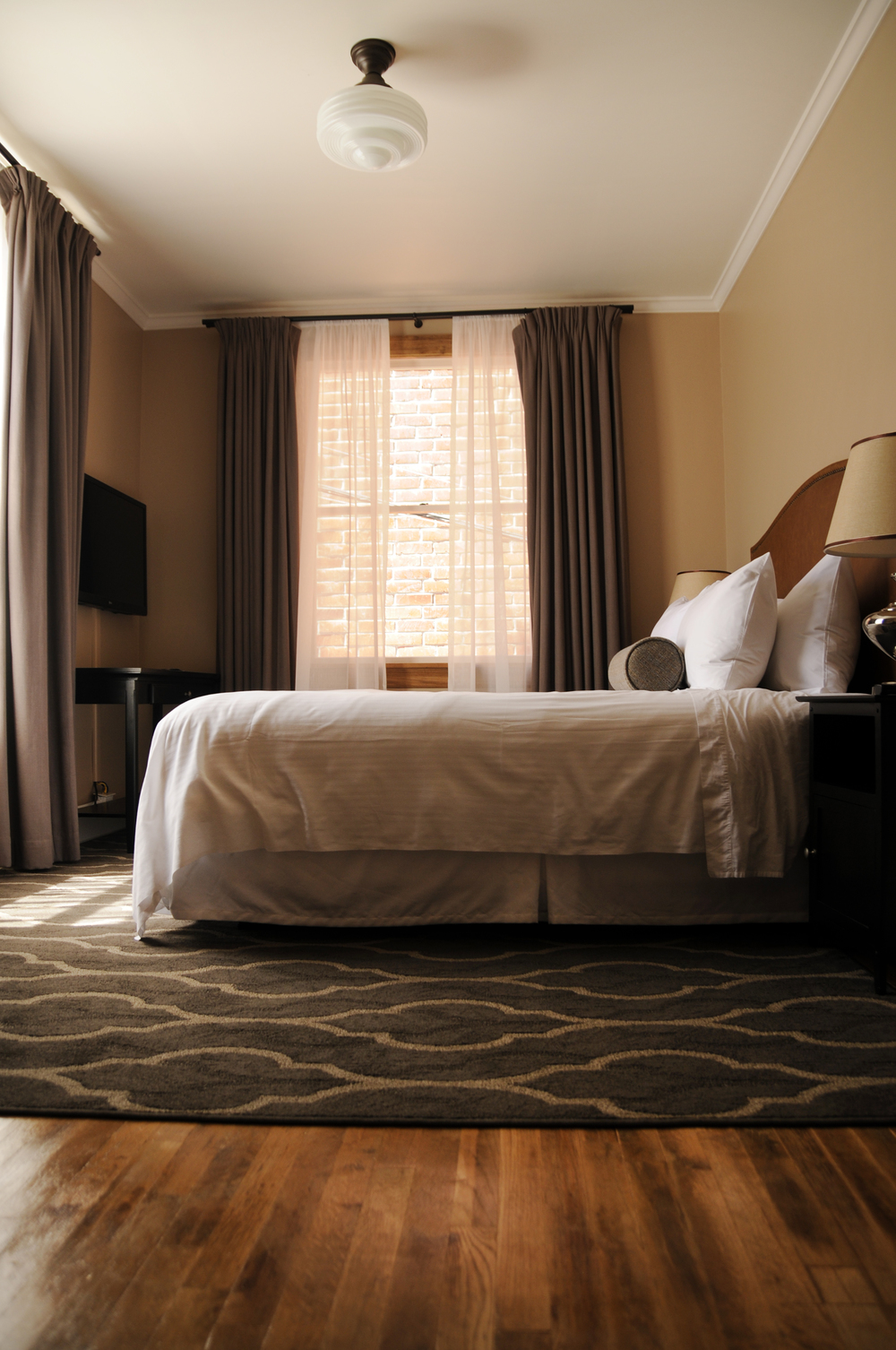The charming rooms feature hardwood flooring, minimalistic style and the comfiest bed you could ask for