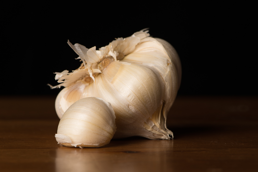 Head of garlic. I love the imperfection in the clove.