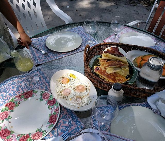 Sarah's homemade berry/cheese blintzes with eggs, awesome Belleville Market bacon, and some fresh summer cucumber juice. She's a backyard brunch queen. #luckyme