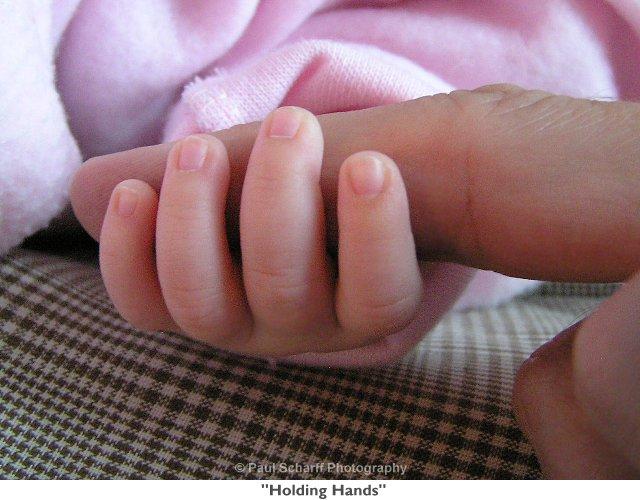 hands - baby holding daddys finger.jpg