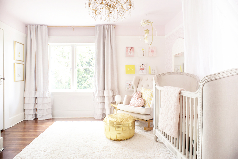 Pink and gold baby nursery in Vancouver, Canada